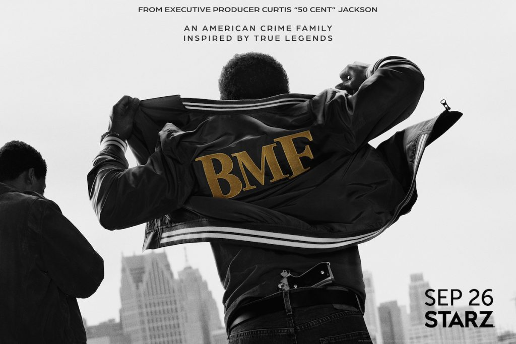 A figure wearing a BMF jacket with a gun tucked into his belt has his back toward the camera with a another figure off to the side in the BMF poster
