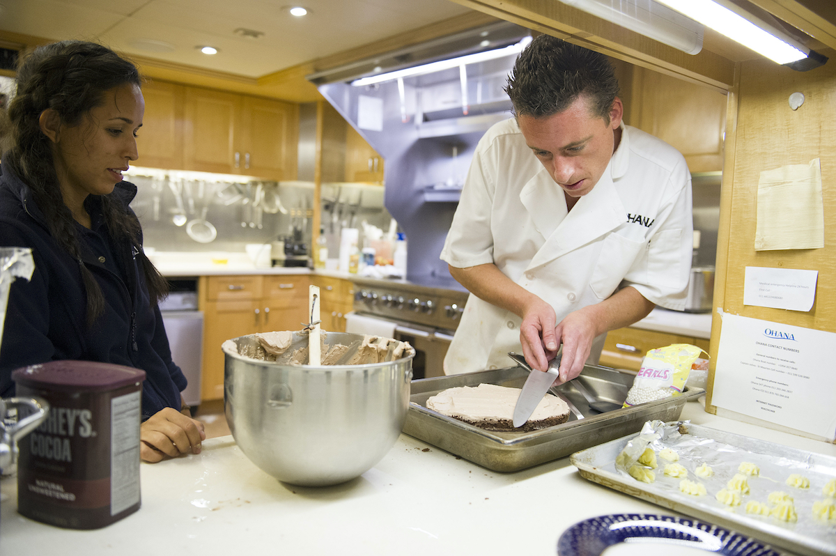 Below Deck's Jennice Ontiveros and chef Ben Robinson work in the kitchen