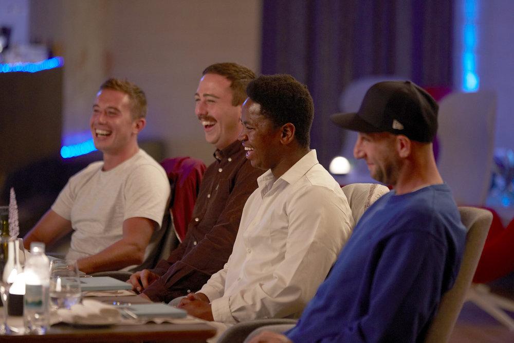 Below Deck Mediterranean's David Pascoe, Lloyd Spencer, Mzi 'Zee' Dempers, Mathew Shea have some laughs at dinner