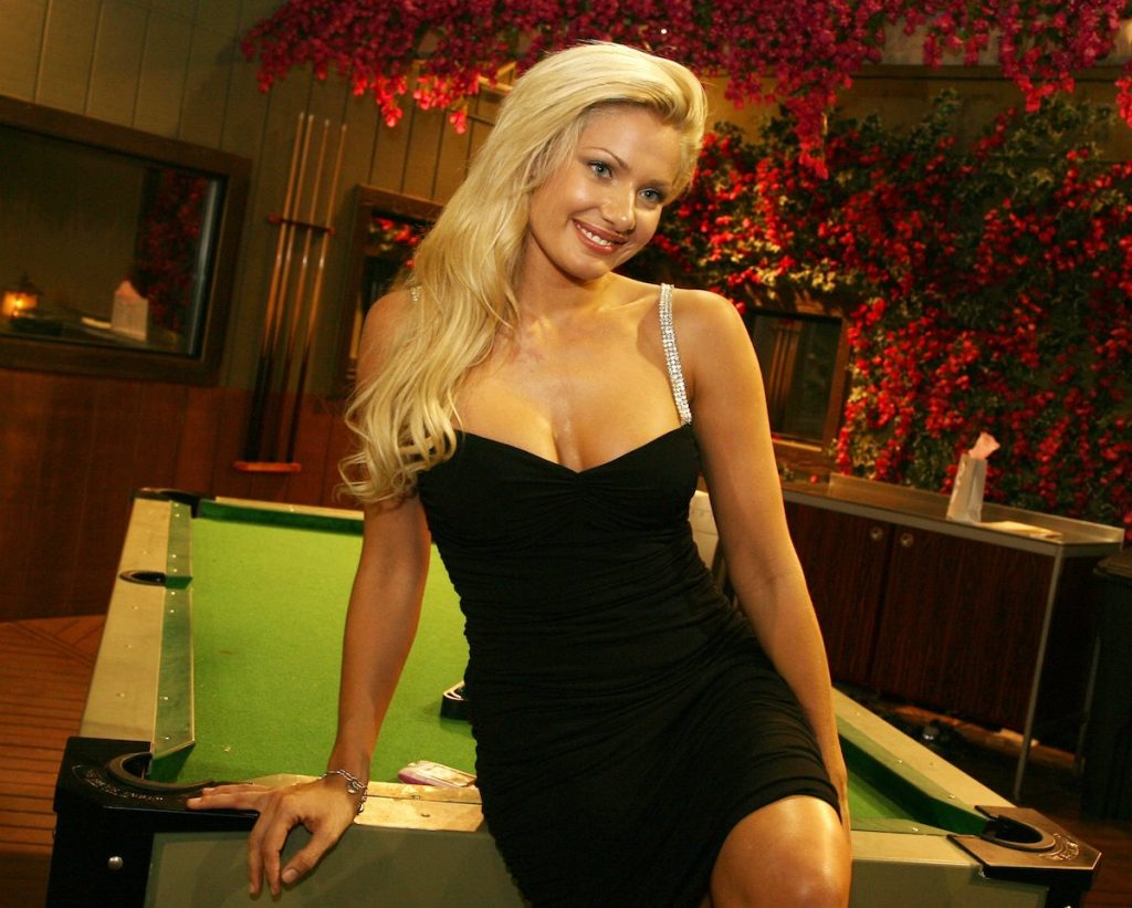 Janelle Pierzina poses in a black dress for 'Big Brother 7'