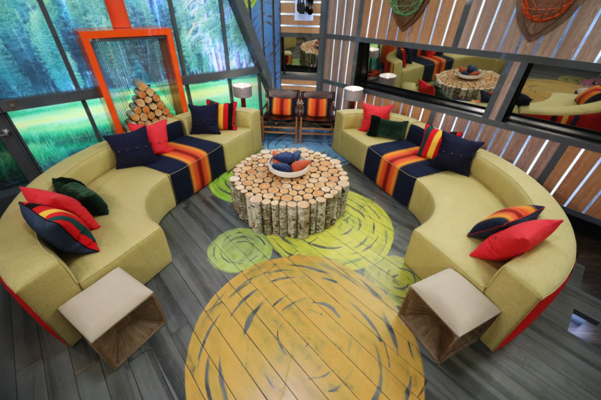 In the living room of the Big Brother House, a 23-foot-high triangular window is backlit by hundreds of LED units, illuminating a lush forest right outside the window