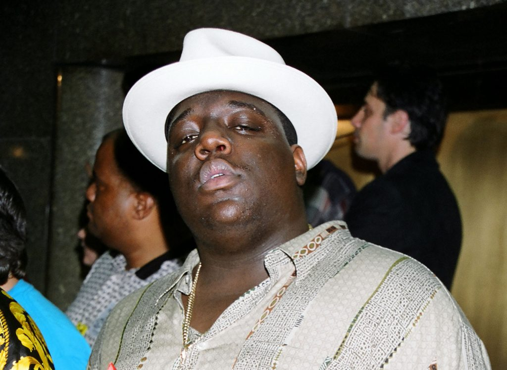 The Notorius B.I.G. wearing a hat