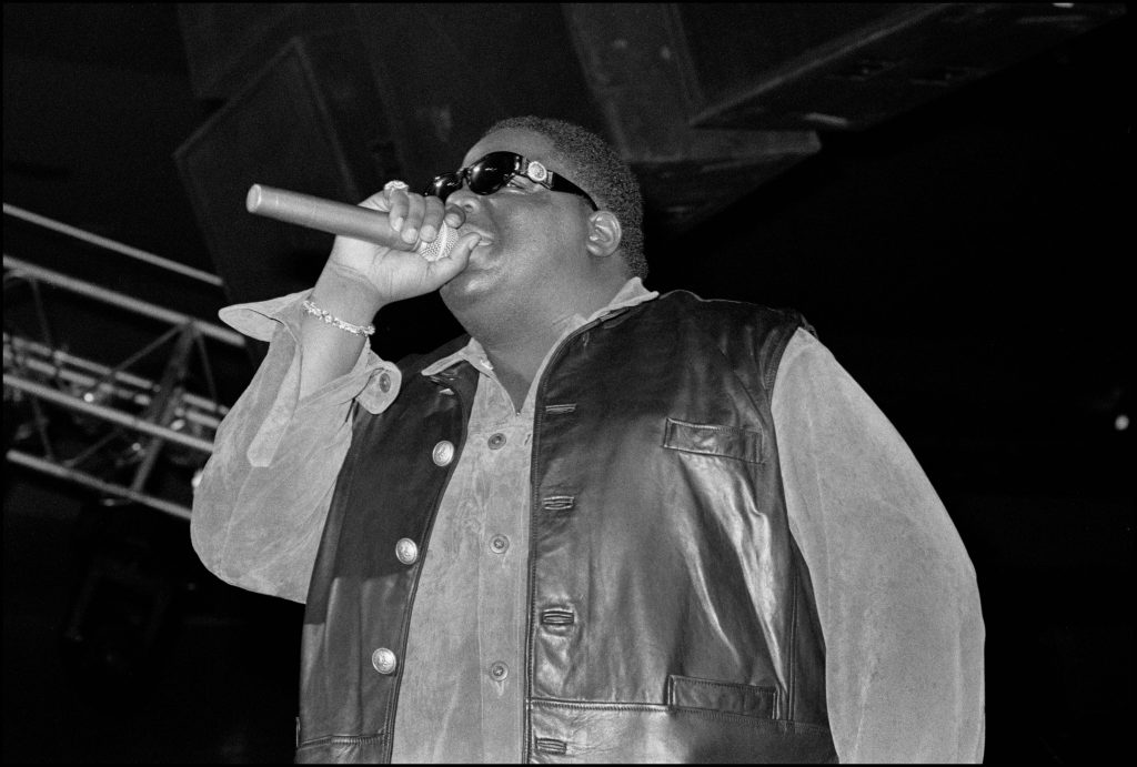 The Notorious B.I.G. performing in a leather jacket