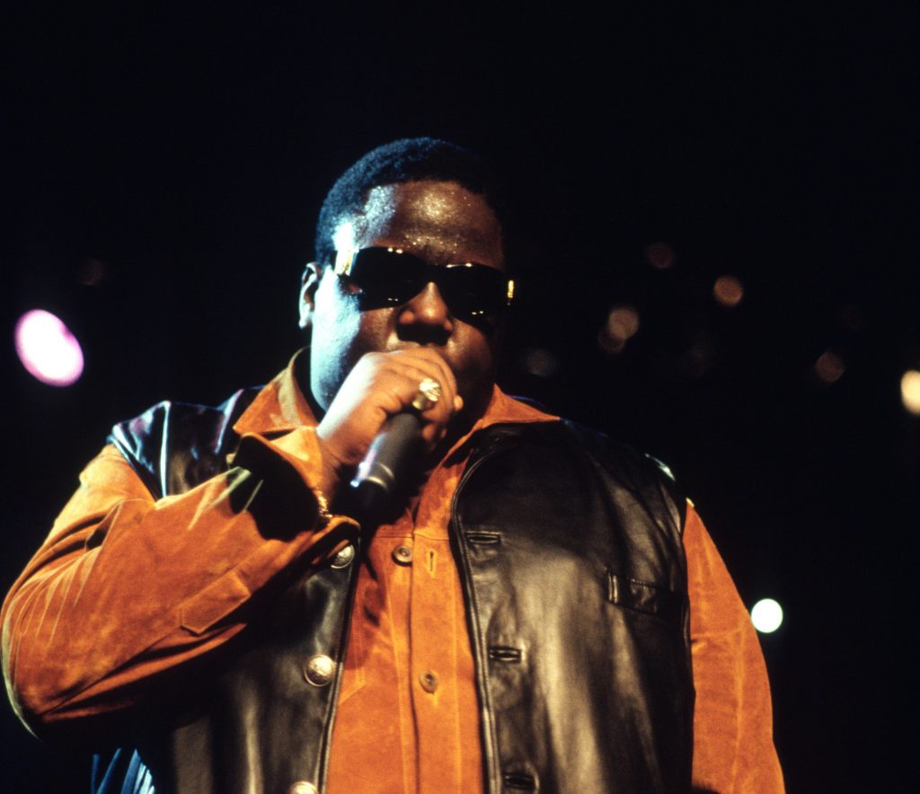 The Notorious B.I.G. performing in a leather vest