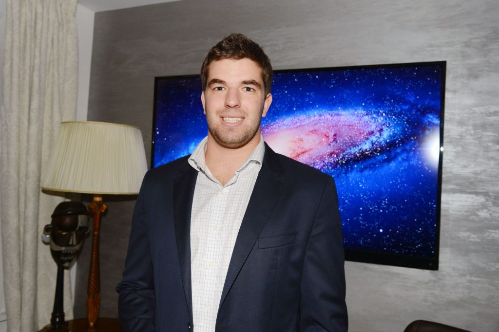 Billy McFarland posing for a picture in his private residence