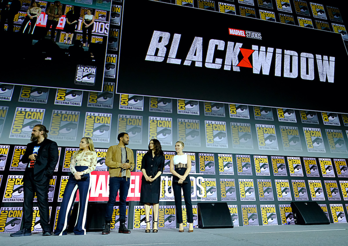 'Black Widow' stars David Harbour, Florence Pugh, O-T Fagbenle, Rachel Weisz, and Scarlett Johansson stand onstage in front of the movie's logo