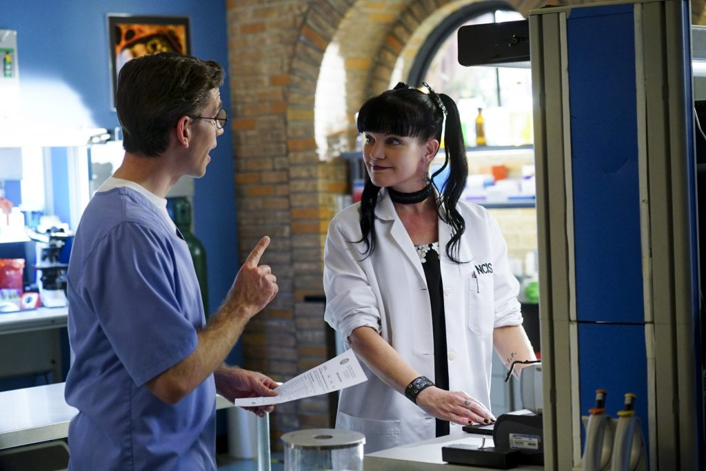 Brian Dietzen and Pauley Perrette talk on the set of NCIS