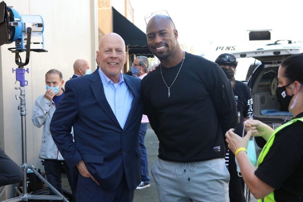 Bruce Willis and Vernon Davis pose for photo on the set of 'Gasoline Alley'