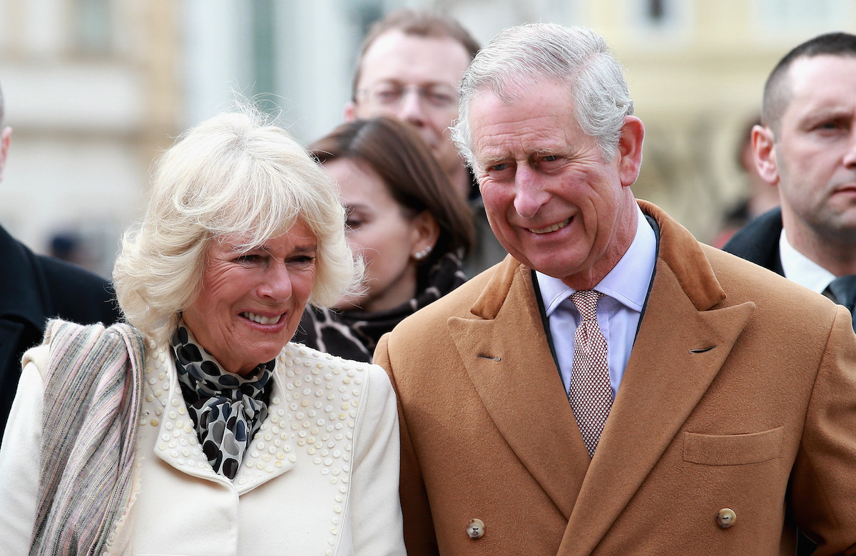 Camilla Parker Bowles and Prince Charles smile as they arrive in Croatia