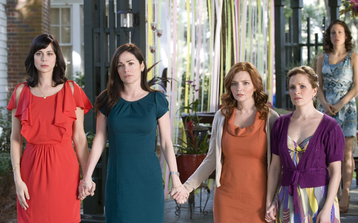'Good Witch' star Catherine Bell and three other women holding hands in an episode of 'Army Wives'