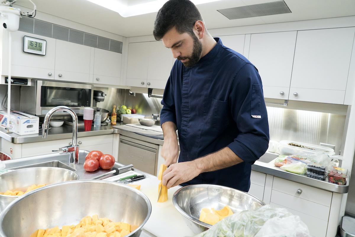 Chef Matt Burns from Below Deck Season 5 prepares a mea