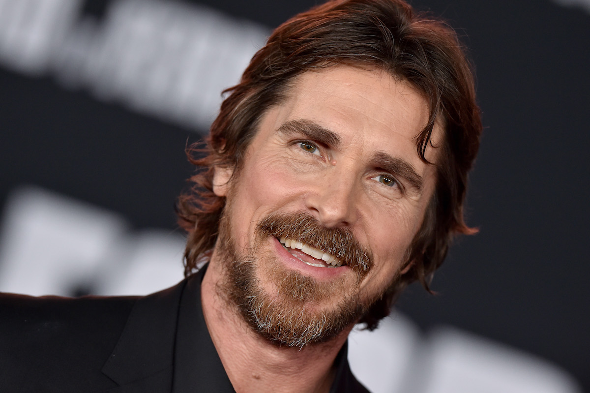 Christian Bale smiles on the red carpet
