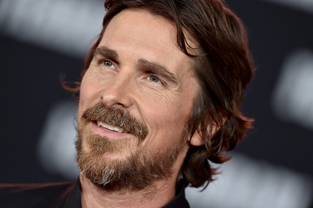 Christian Bale wears black and smiles at the 'Ford v Ferrari' premiere