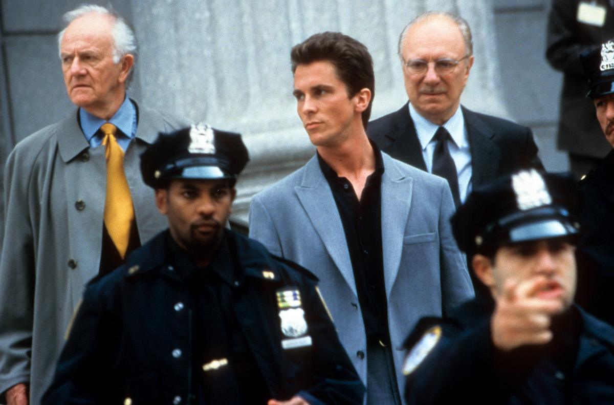 Christian Bale with officers in front of him in a scene from the 2000 film 'Shaft'