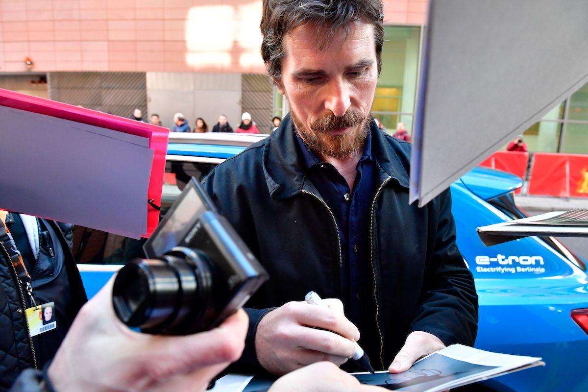 Christian Bale signs autographs for fans