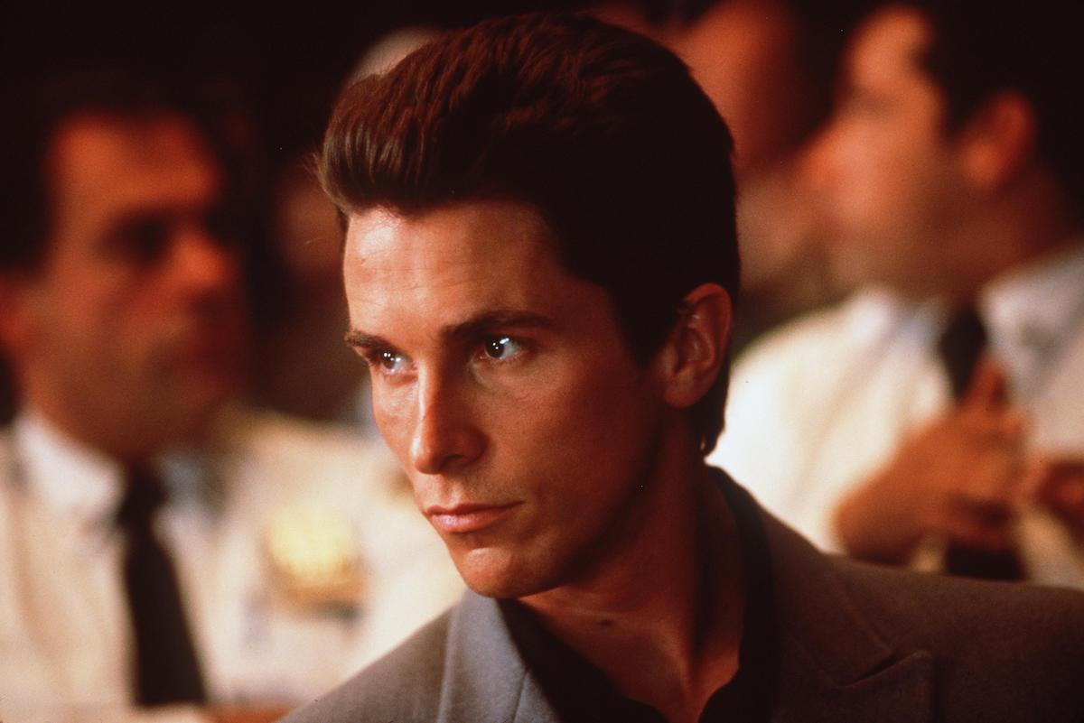 Christian Bale wears a suit and looks off into the distance in scene from the 2000 movie 'Shaft'