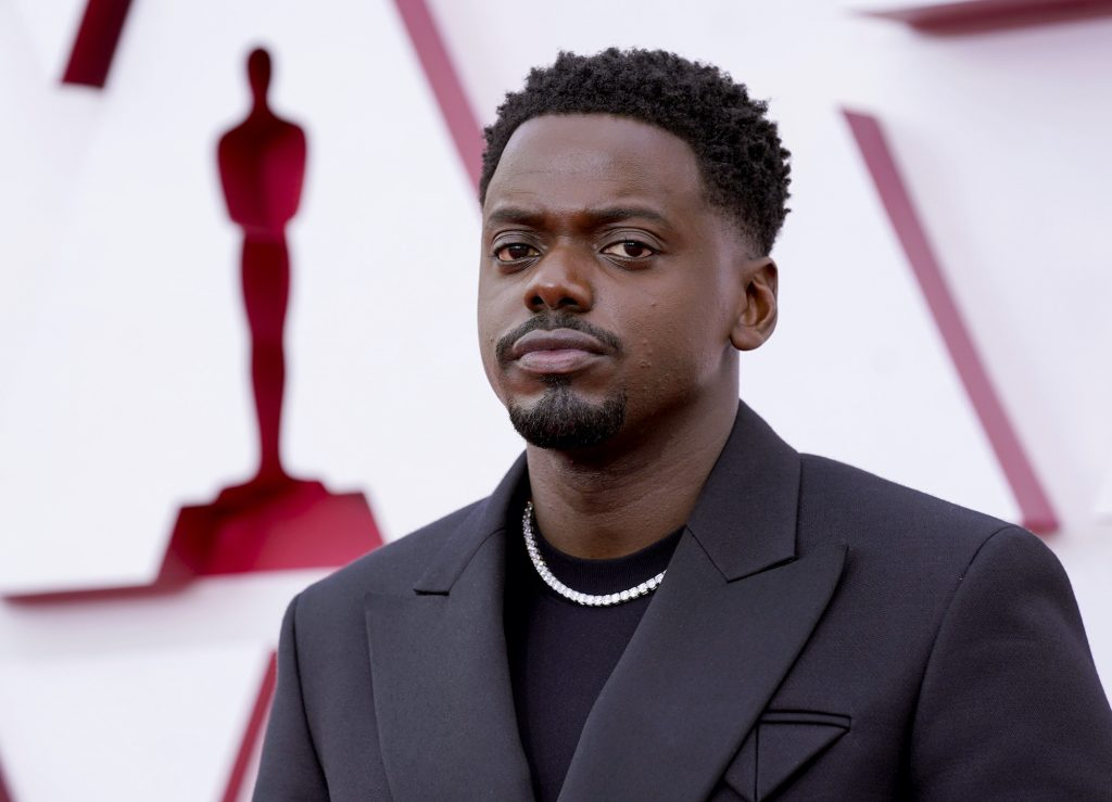 Daniel Kaluuya standing in front of a blurred background