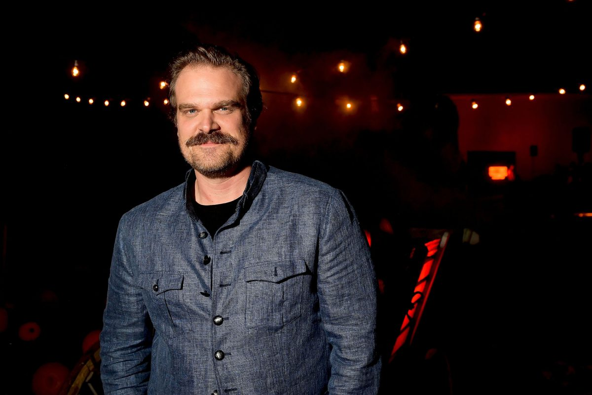 'Black Widow' star David Harbour wears a blue shirt and smiles