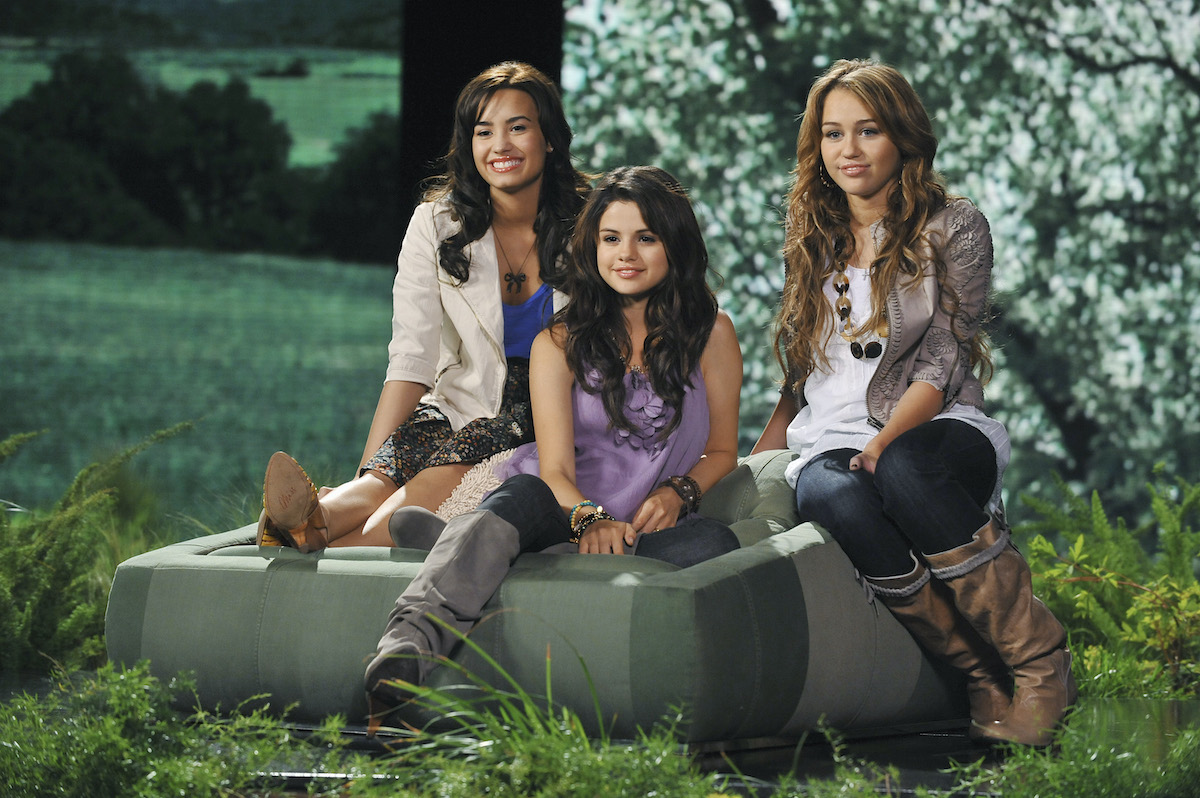 Demi Lovato Selena Gomez and Miley Cyrus pose for Disney's Friends for Change