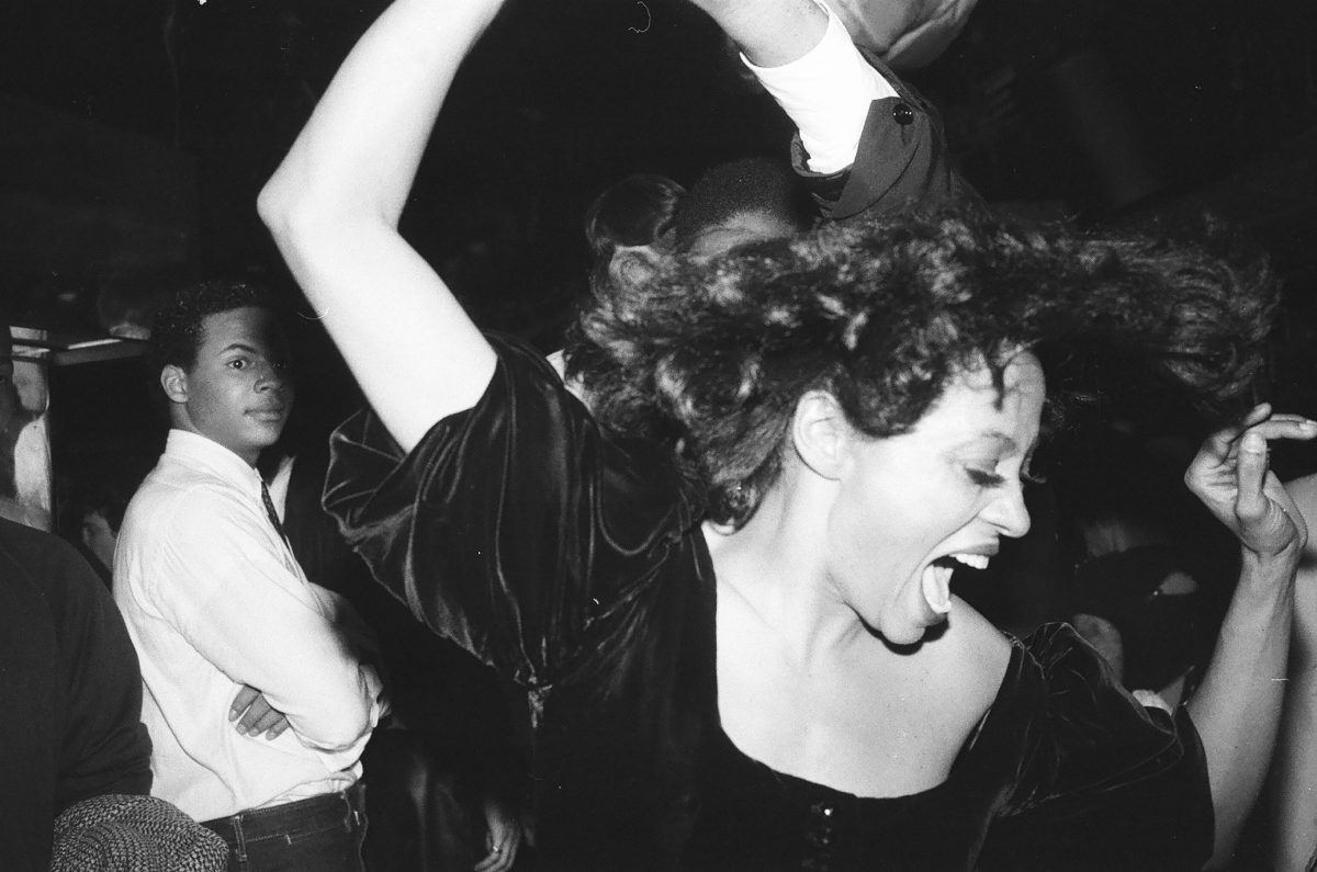 Diana Ross wearing a black top and lipstick at Studio 54.