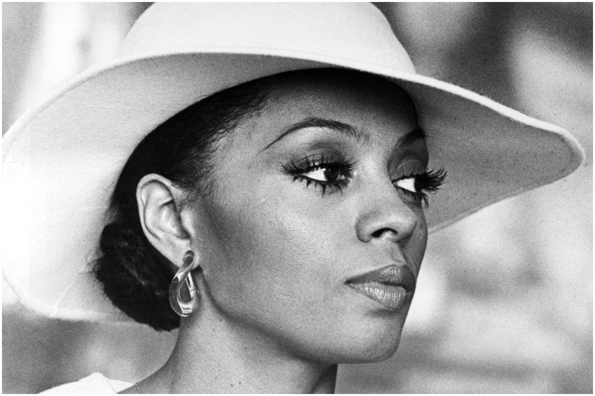 Diana Ross staring intensely while filming a scene as Tracy Chambers in 'Mahogany'
