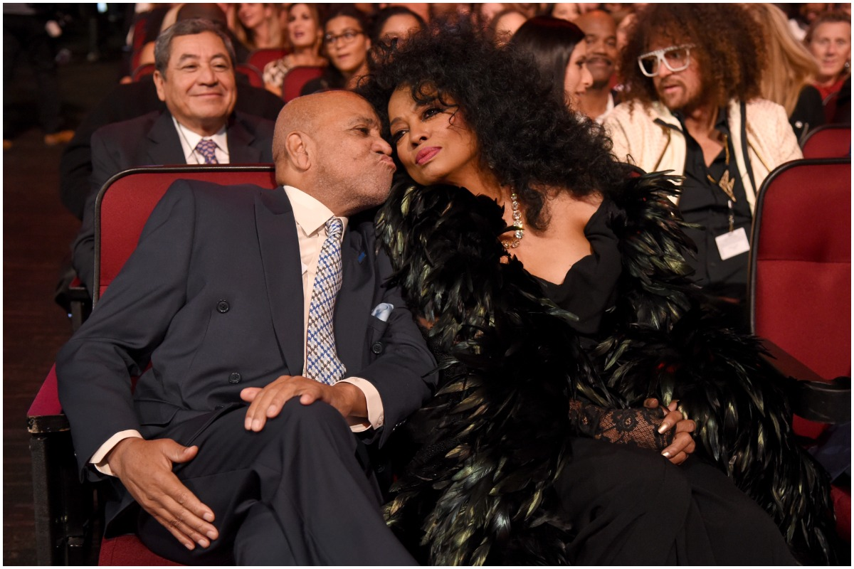 Diana Ross and Berry Gordy kissing at an awards show.