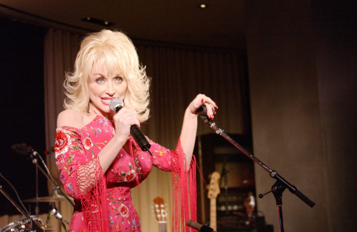 Dolly Parton singing into a microphone at the Tennessee Film & Music Commission's industry reception at the W Hotel on October 15, 2002 in Westwood, California.