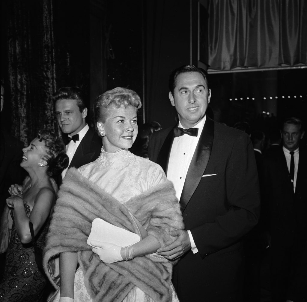 Doris Day with Marty Melcher at the film premiere of 'A Star Is Born' featuring Judy Garland.