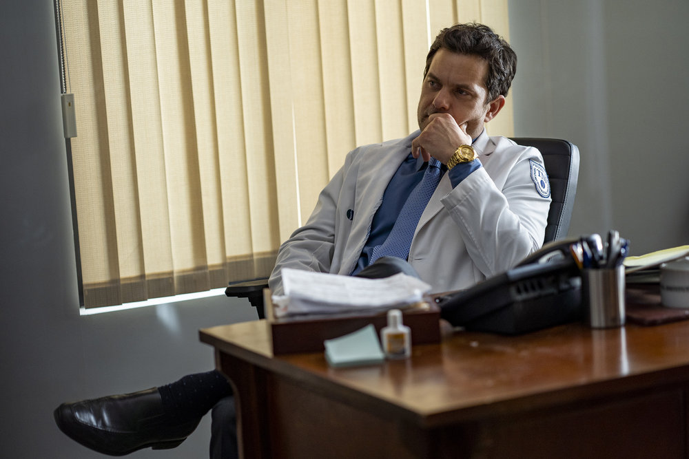 Joshua Jackson as Christopher Duntsch, wearing a lab coat, seated