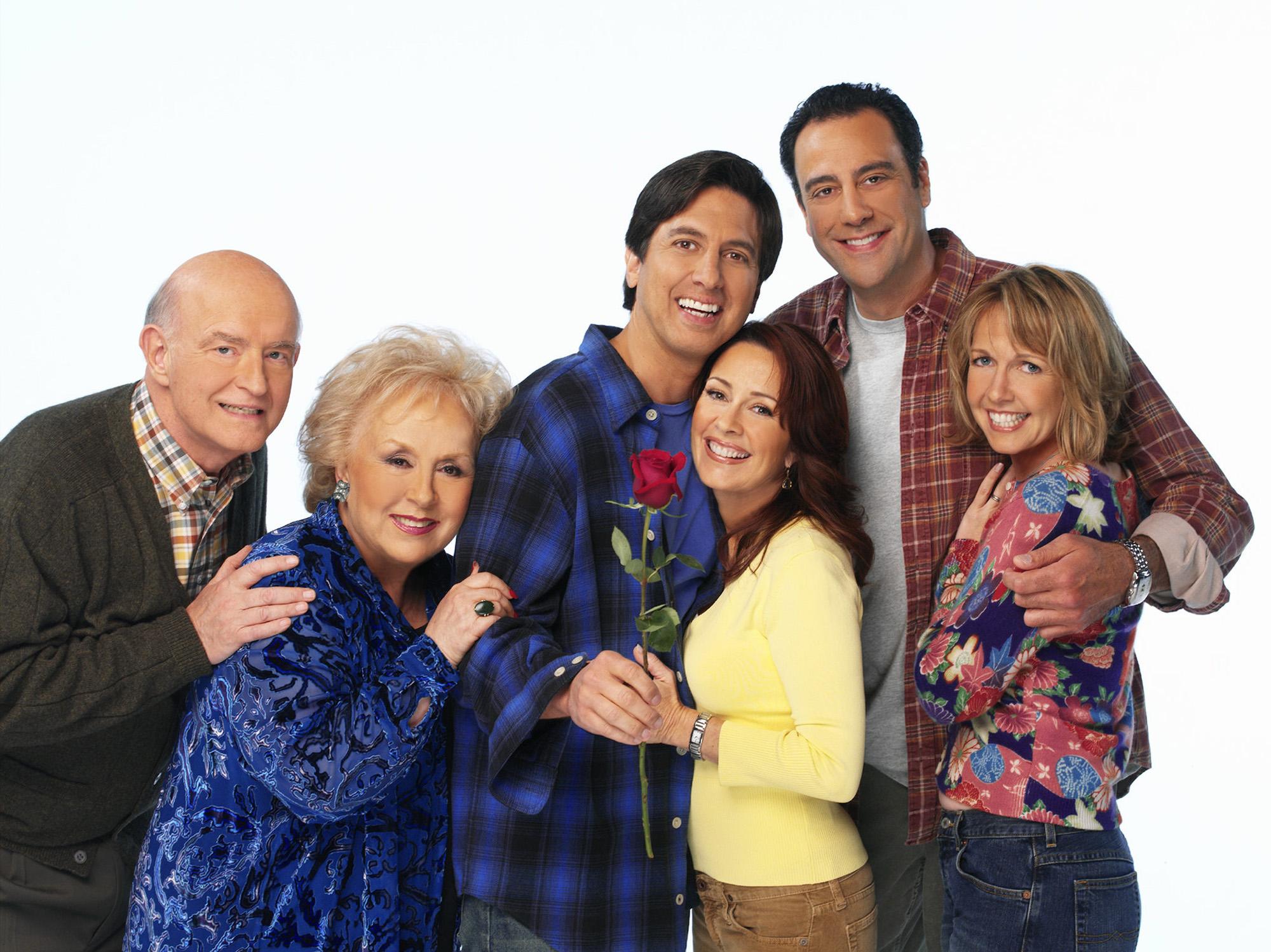 The cast of 'Everybody Loves Raymond' - Peter Boyle, Doris Roberts, Ray Romano, Patricia Heaton, Brad Garrett, and Monica Horan - poses for a photo.
