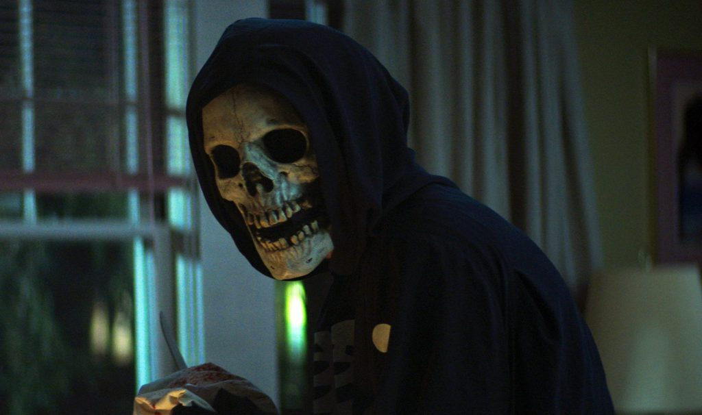 Netflix film 'Fear Street Part 3: 1666' sees the Shadyside killer wearing a skull mask and standing by a window