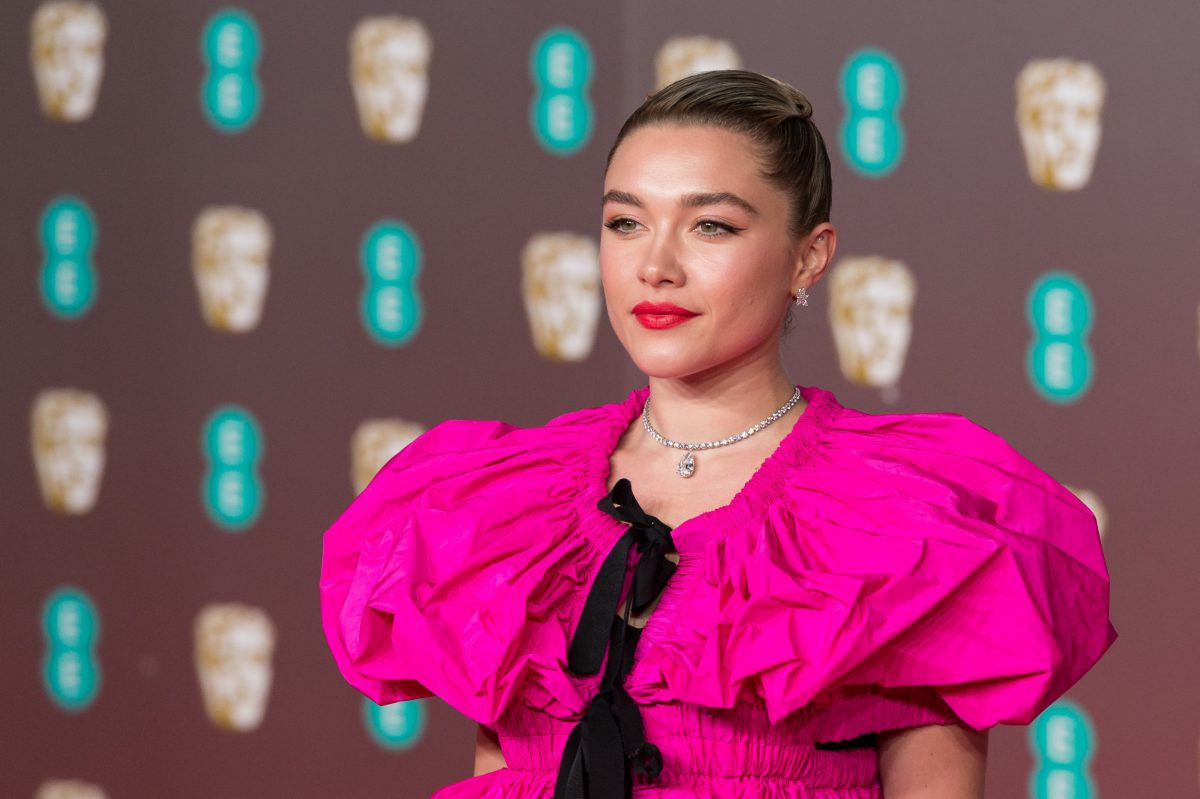 Florence Pugh wearing a pink ruffled dress with her hair tied back