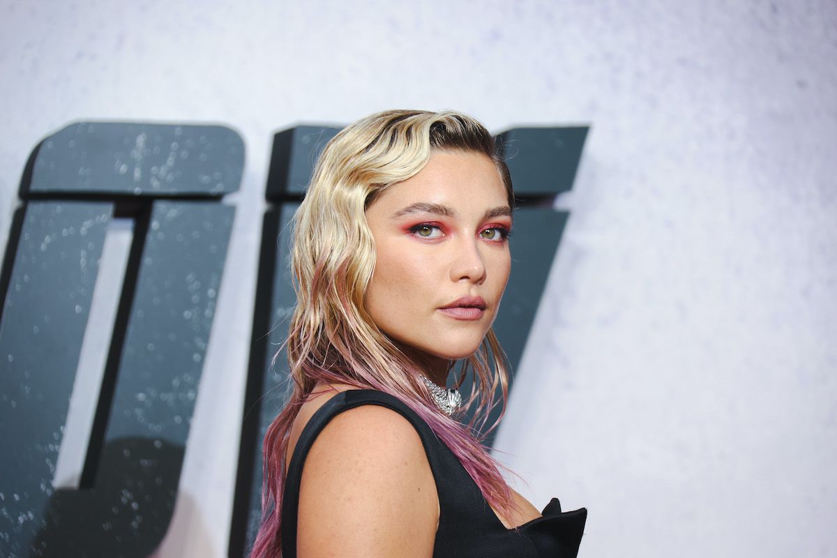 Florence Pugh wears black and poses at the 'Black Widow' UK premiere