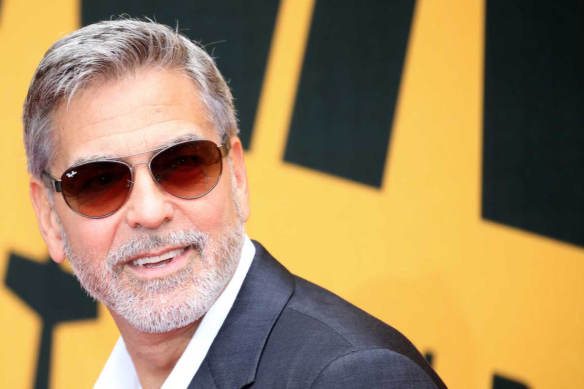 George Clooney wearing sunglasses on the red carpet