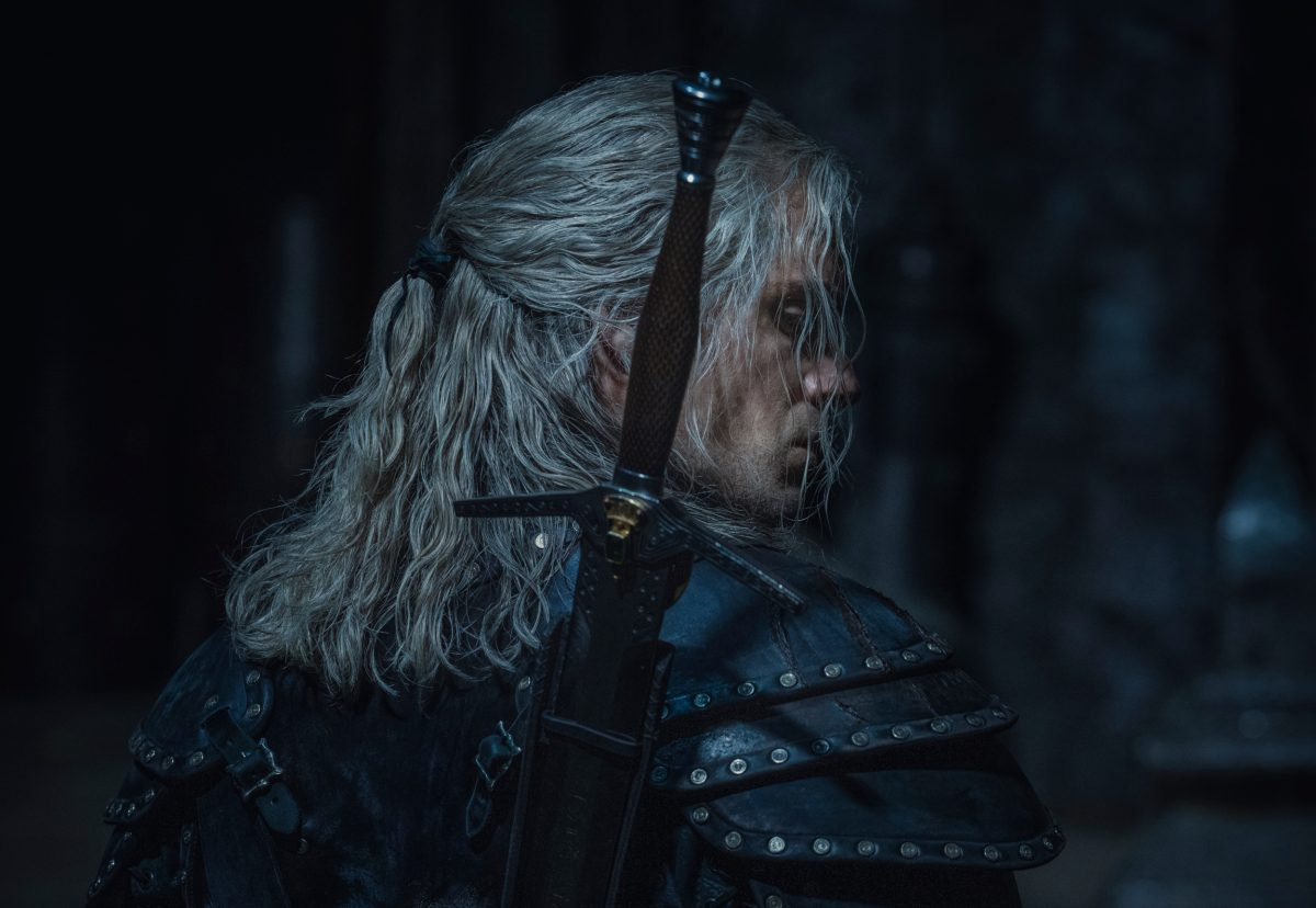The Witcher Season 2 still of Henry Cavill as Geralt of Rivia (Henry Cavill) wearing a sword and armor
