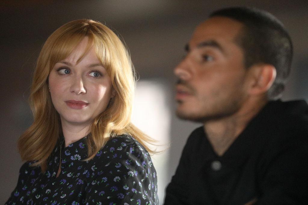 Christina Hendricks as Beth Boland looks over at Manny Montana as Rio.