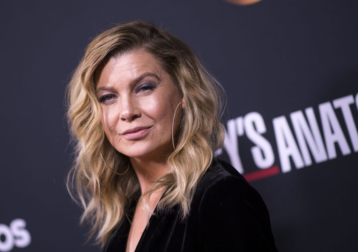 'Grey's Anatomy' star Ellen Pompeo smirking as she looks at the camera while attending an event.