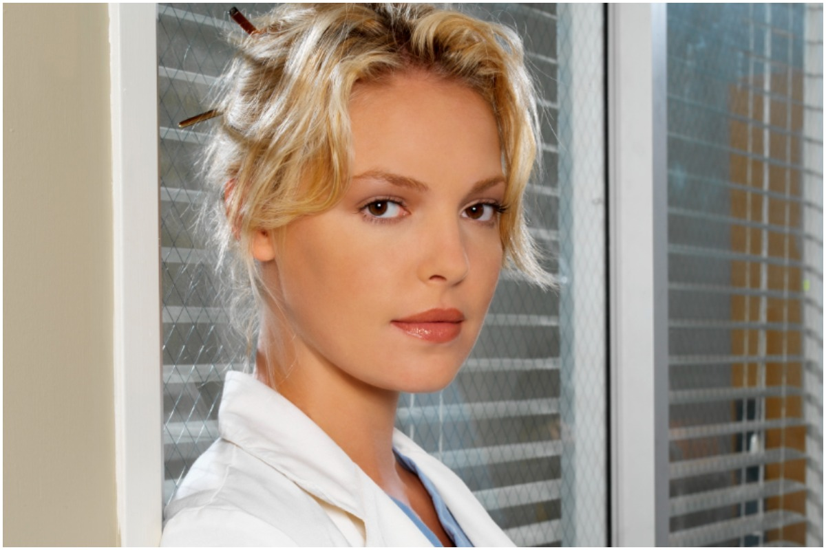 'Grey's Anatomy' star Katherine Heigl as Izzie staring intensely at the camera while wearing medical scrubs.