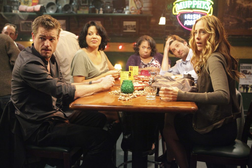 Is Joe's Bar on 'Grey's Anatomy' a real establishment in Seattle? Pictured here are a team of doctors from the show celebrating at Joe's Bar.