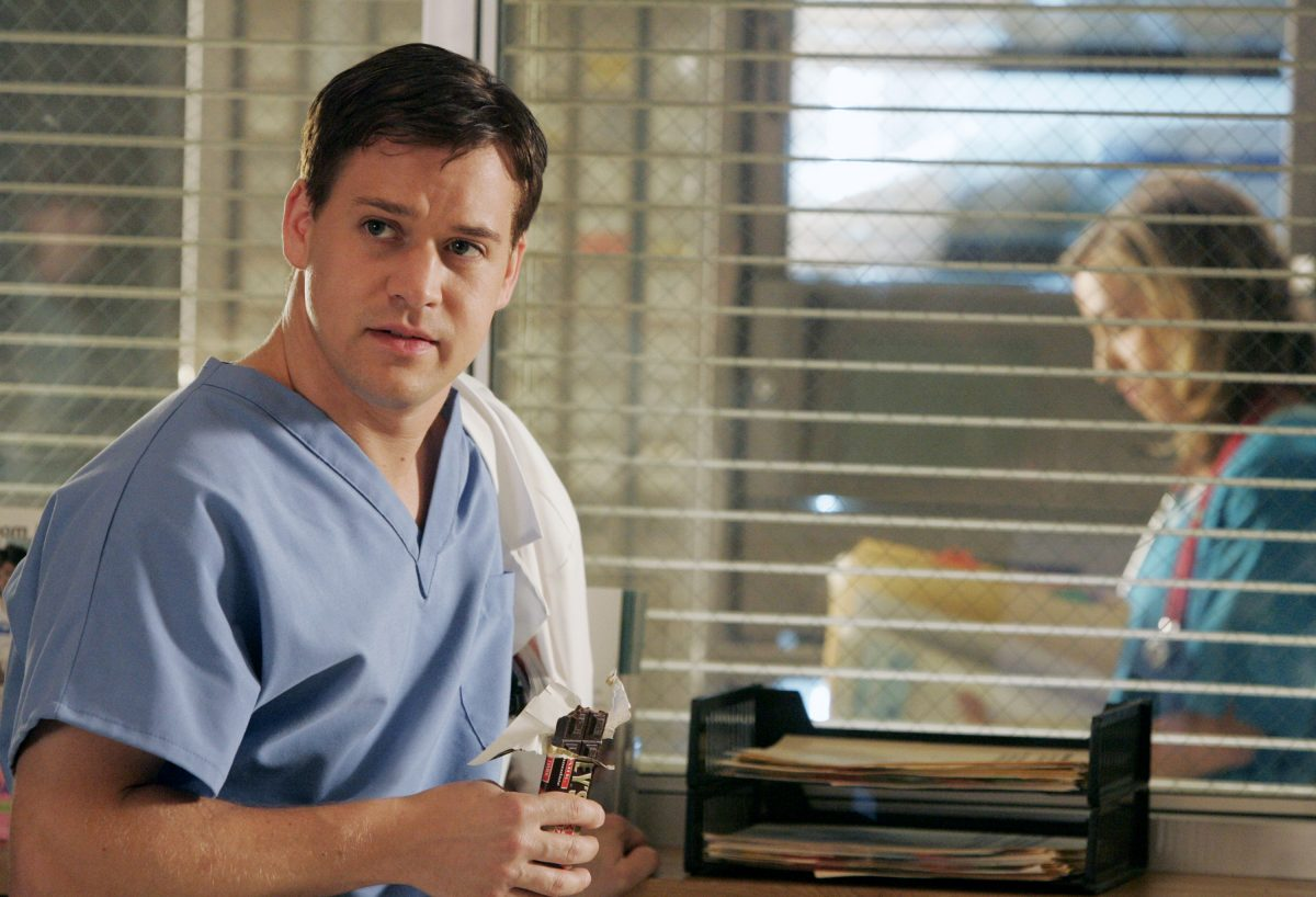 'Grey's Anatomy' actor T.R. Knight wearing light blue medical scrubs as George O'Malley.