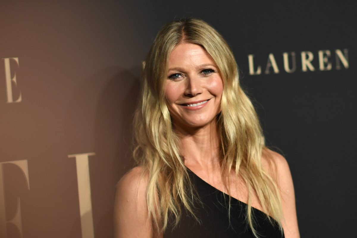 Gwyneth Paltrow wearing a black, off-the-shoulder dress on the red carpet