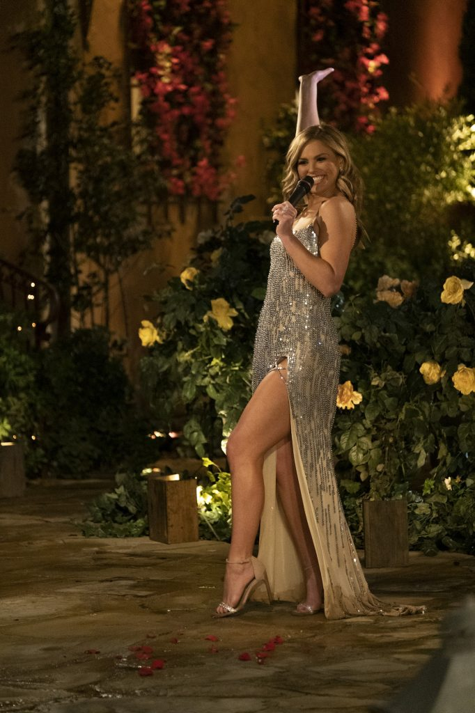 Hannah Brown in one of the best 'Bachelorette' looks holding a microphone