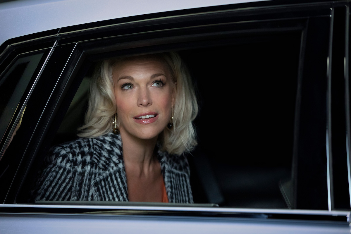 Hannah Waddingham sits in a car with the window rolled down as Rebecca Welton on 'Ted Lasso'