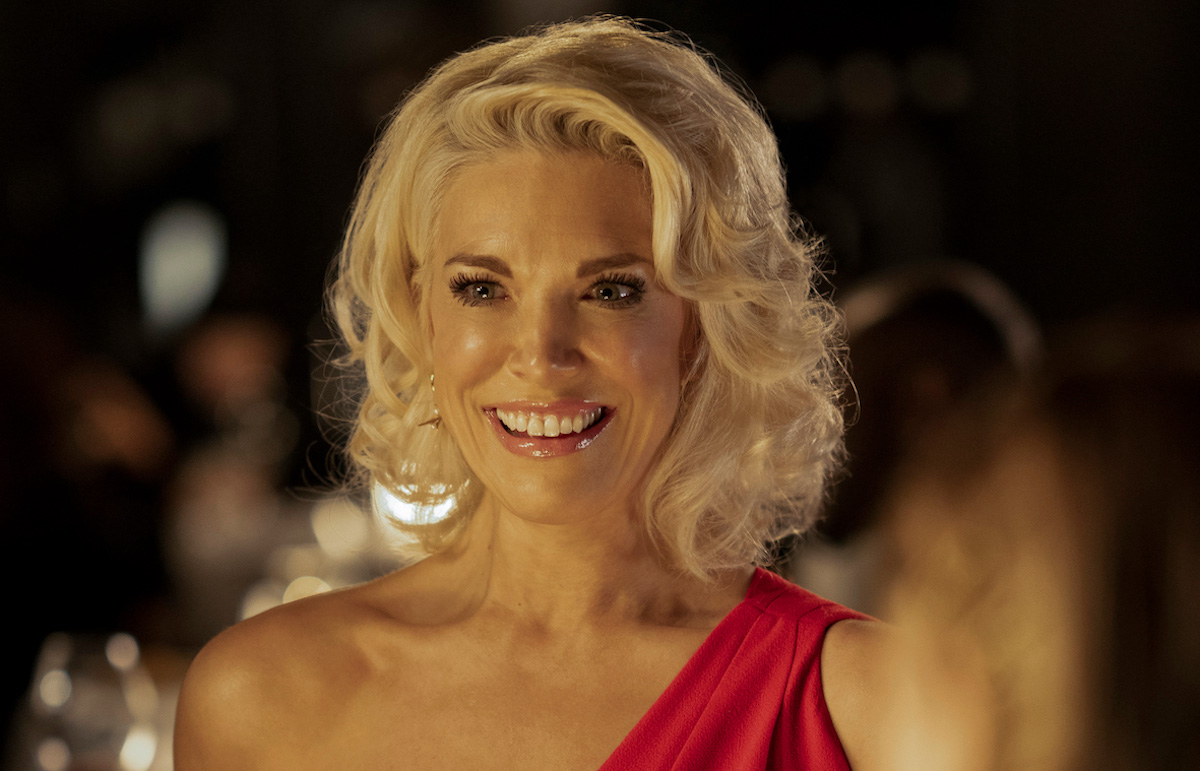 Hannah Waddingham smiles wearing a red dress as Rebecca Welton on 'Ted Lasso'