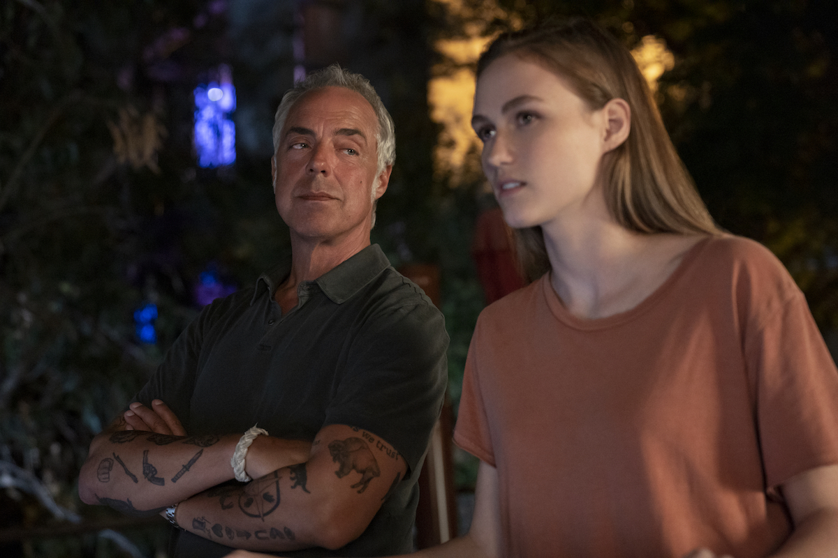Harry Bosch with crossed arms looking at Maddie Bosch in 'Bosch'