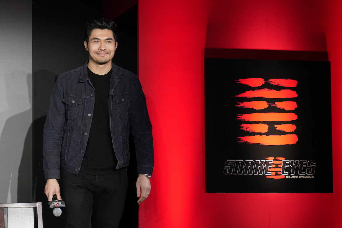Henry Golding poses at a red carpet even celebrating the production start for 'Snake Eyes'