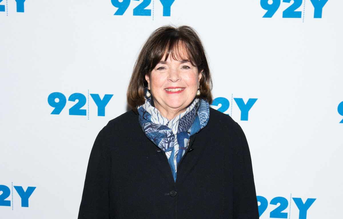Ina Garten smiling in front of a white background
