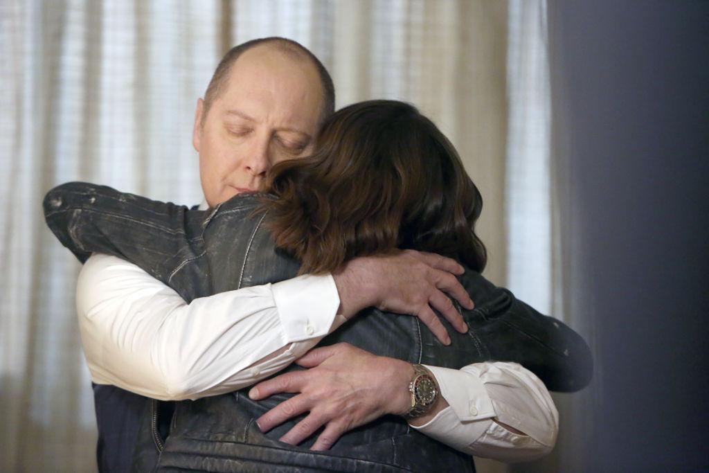 James Spader as Raymond 'Red' Reddington hugs Megan Boone as Elizabeth Keen.