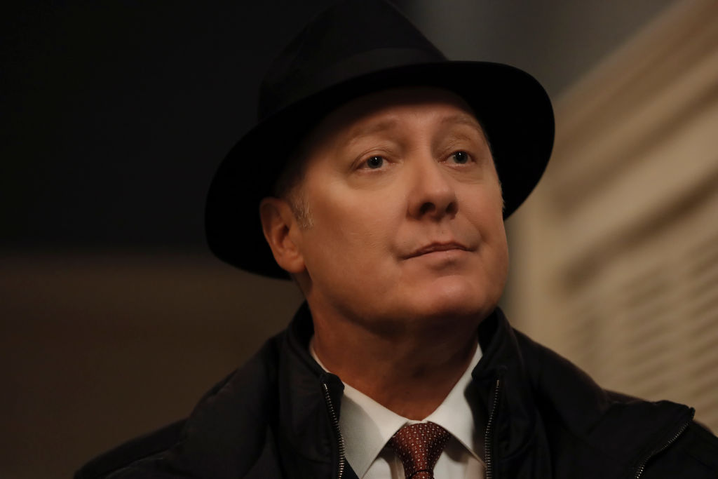 James Spader as Raymond 'Red' Reddington wears his trademark black fedora while looking just off-camera.