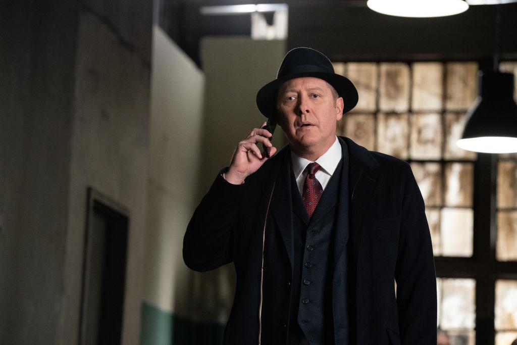 James Spader as Raymond 'Red' Reddington looks concerned as he talks on the phone.